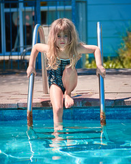 Rosa, Labour Weekend 17 (ArdieBeaPhotography) Tags: blue water pool swim kid child kindergarten red girl concrete little small flags blonde onepiece swimsuit togs toobig bathers saggy overlarge test cold smile dark spring eyes sunny tentative patterned tamronaf70300mmf456divcusdif