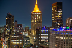 Chelsea from Midtown lll (fate atc) Tags: chelsea manhattan newyork newyorklifeinsurancebuilding west28thst buildings city frommidtown lights nightphotography skyline