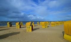Cuxhaven - Nobody at the Beach (cnmark) Tags: beach germany deutschland cuxhaven niedersachsen lowersaxony sea sky clouds strand north himmel wolken nordsee strandkorb strandkörbe ©allrightsreserved rainbow regenbogen