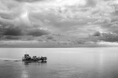 mastery... (Vladimir Barvinek) Tags: sea boat fishing trawler mussel crew devon exmouth sky drama cloud shore silhouette season mono monochrome blackandwhite tide
