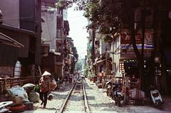 Hanoi Train Street (hiphopmilk) Tags: copyright©jaredyehwooehmoehfilms film analog analogue 35mm 135film kodakfilm kodak jaredyeh hiphopmilk nikonfm2 nikonfm2n nikon nikkor vietnam hanoi travel street streetphotography rail railway railroad track vendor