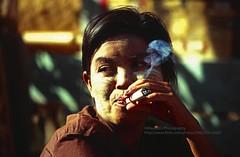Kyaiktiyo, smoking (blauepics) Tags: myanmar birma burma southeast asia südostasien 1996 kyaiktiyo kyaiktio woman girl frau mädchen burmese birmanin face gesicht portrait porträt light licht illumination beleuchtung lighting market markt smoking rauchen