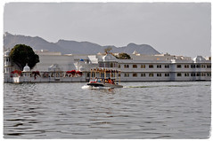 Lake Pichola- Home of Palaces (The Spirit of the World ( On and Off)) Tags: palace palaces lakepichola udaipur india rajasthan boat tajlakehotel hills waterscape sightseeing trees bougainvillea