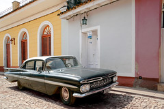 Olga's Chevy (karzvin19) Tags: classiccars vintagecars cuba trinidadsanctispirituscuba trinidadcuba streets colorfulcities colorfulstreets cobblestonestreets yellow chevy59 chevrolet