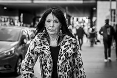Panthera Pardus Fictus (Leanne Boulton) Tags: urban street candid portrait portraiture streetphotography candidstreetphotography candidportrait streetportrait eyecontact candideyecontact streetlife woman female lady face eyes expression mood emotion fur furry faux coat leopard pattern hair style fashion tone texture detail depthoffield bokeh naturallight outdoor light shade city scene human life living humanity society culture lifestyle people canon canon5dmkiii 70mm ef2470mmf28liiusm black white blackwhite bw mono blackandwhite monochrome glasgow scotland uk