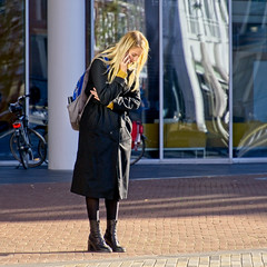 Patience (Hindrik S) Tags: calling bellen phone phonecall smartphone woman girl lady coat jas manteau mantel boots blond waiting wait wachtsje wachten warten human people candid ljocht licht streetphoto strjitfotografy strasenfotografie straatfotografie vrouw frau frou femme female sonyphotographing sony sonyalpha on1pics on1photoraw2019 2019 a77ii α77 slta77ii sonya77ii sonyilca77m2 tamron tamronaf16300mmf3563dillvcpzdmacrob016