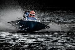 Powerboat racer (bobbyloomba) Tags: sport speedboat powerboat water headgear helmet waves