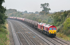 66070 dragging 60011 6B41 1108 Westerleigh - Robeston at Standish Junction taken on 31.10.2019 after 60011 failed at Westerleigh on 30.10.2019 (The Cwmbran Creature.) Tags: british rail class train trains railway tanks tankers fuel freight dbs 60 tug 66 shed