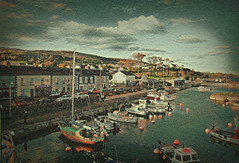 Carnlough Harbour (Rollingstone1) Tags: carnloughharbour countyantrim northernireland sea water boats fishing trips boating sailing town village shops road cars hills cliffs trees clouds sky outdoor colour texture art artwork