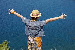 On top of the world! (m_artijn) Tags: sea hill arms hat sun komodo national park padar island id