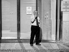 (graveur8x) Tags: man smoking candid street potrait wroclaw poland tie mustache blackandwhite monochrome schwarzweis streetphotography europe sun contrast light eyecontact olympus olympuspenf urban mann strase polen lumixgvario1232f3556
