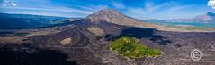 Black lava flows around the active volcano Mount Batur in Bali, Indonesia (WhitcombeRD) Tags: flow mountbatur active landscape bali volcanic aerial volcano eruption batur drone lava nature black balinese gunung blacklava indonesia mountain