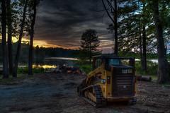 Caterpillar Campfire (Brad Prudhon) Tags: 2019 259 animals cat caterpillar chickahominylake edallenscampground may providenceforge skidsteerloader virginia williamsburg sunset