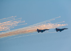 Two of MiG-29 fighters, deploying flares (andrey.isakov) Tags: plane fighter jet sky airshow maks russia moscow blue mig strizhi aircraft flight dslr canon