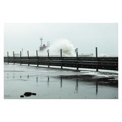 Stormy Sea (John Pettigrew) Tags: waves tamron d750 imanoot banal storm pier car nikon gorleston barriers park signs johnpettigrew sea seascape