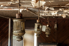 The Hanging Lamps (Devon OpdenDries) Tags: abandoned fire damage smoke soot burnt old derelict decay forgotten resort restaurant fishing hunting northern ontario canon5dmkii