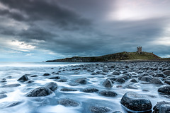 Dunstanburgh Castle (Michael Long Landscaper) Tags: northsea longexposure nationaltrust landmark tower castle rocks old beech dunstanburghcastle dunstanburgh northumberland coast england craster embleton fort englishheritage lownewton cloud landscape seaweed canon eos