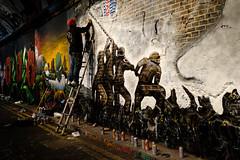 Raise A Flag (Sean Batten) Tags: london england unitedkingdom leakestreet thetunnel graffiti streetphotography street fuji fujifilm x100f city urban person painter ladder