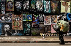 Walking on a street (stephenccwu) Tags: poverty streetvendor southafrica streetart nikonz6 streetphotography man johannesburg south africa colour