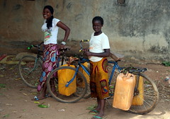 Carrying Water On Their Bikes (Alan1954) Tags: africa holiday 2017 ivorycoast cotedivoire bikes watercontainers two women