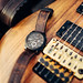 Fossil watch on Charvel San Dimas electric guitar. Brown autumn colors.