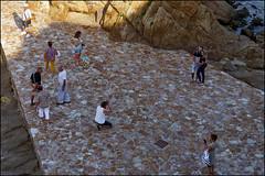 Posing Under Sa Palomera   Blanes, Catalonia (Flemming J. Gade) Tags: photographers posing rocks people couple camera sapalomera blanes catalonia