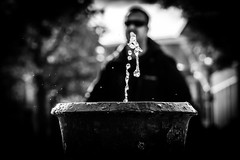 the shape of water and the preacher (Gerrit-Jan Visser) Tags: water gold future drinking amsterdam bnw blackandwhite thirst warmingup preacher thirsty explore decisive moment