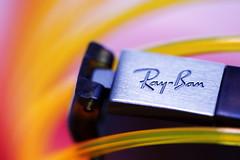 My Ray-Ban glasses (Christian Chene Tahiti) Tags: canon 6d marque lunette pairedelunettes glasses noir lunettedesoleil sunglasses rayban macromondays macro hmm brandandlogos macrolens polynésie blanc tahiti paea bokeh rouge rose bleu brand logo jaune orange lunettessolaires