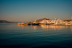 Island harbour...... (Dafydd Penguin) Tags: island harbour sun sunrise set sunset light golden ferry terminal harbor port dock water sea blue land coast coastal salamis saronic gulf greece aegean mediterranean leica m10 35mm summicron f2 asph