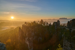 The classical view: Sunrise over Bastei rock (Petra S photography) Tags: bastei basteibrücke basteifelsen saxony sachsen sächsischeschweiz saxonswitzerland elbsandsteingebirge elbesandstonemoutains sunrise fog mist osterzgebirge felsenburgneurathen