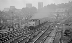 Guildford UK     1981 (keithwilde152) Tags: br class50 50009 conqueror guildford surrey hills uk 1981 tracks junction yards railway townscape passenger train diesel locomotives blackandwhite monochrome outdoor summer