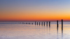 Poles! (karindebruin) Tags: maasvlakte nederland noordzee northsea thenetherlands zonsondergang zuidholland afzetting hightide hoogwater paaltjes poles sunset water