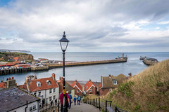 SJ2_1960  - The 199 steps at Whitby (SWJuk) Tags: whitby england unitedkingdom swjuk uk gb britain yorkshire northyorkshire yorkshirecoast coast coastal hills hillside cliffs steps houses lamppost seaside sea seascape harbour piers tidal river riveresk landscape headland sky clouds cloudy redrooftiles 2019 sep2019 autumn autumnal holidays nikon d7200 nikond7200 nikkor1755mmf28 rawnef lightroomclassiccc