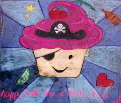 Pirate cupcake (wwimble) Tags: pastels streetart viacolori shortnorth columbus ohio cupcake happy talklikeapirateday frosting bottleofrum heart stars cherry skullandcrossbones eyepatch ring 2009