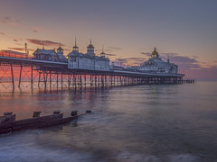 A magic day awakens (Wizard CG) Tags: tags uk eastbourne pier england water long exposure sunrise sea beach east sussex united kingdom dawn victorian ocean sand stones reflection reflections clouds sun olympus epl7