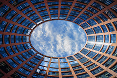 European Parliament (Louise Weiss-Building) in Strasbourg - France (Patrik S.) Tags: sky mirror sony a7m3 a7iii photography day house urban travel living city life de development area ngc time historic famous colorful blue exposure eu european parlimant strassburg france glass building government clouds light party union ep law vote people europeanparliament glassfront weather sunny reflection straightup sun shadow circle eggshaped oval egg