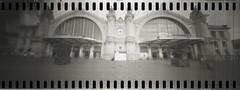 Gare de Tours (Vaidotas Mikšys) Tags: doubleslit ikea table leg gare de tours train station france panorama film monochrome horloge entrance entrée chemin ferre ilford hp5 hc110 camera slitpinhole