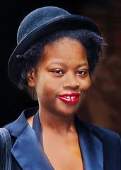 Portrait (D80_546579) (Itzick) Tags: manhattansep2019 nyc candid color colorportrait blackwoman face facialexpression streetphotography smile hat portrait d800 itzick