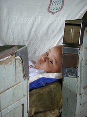 Medium View Baby Rests Thougtfully on Train in Burma (jasonrosette) Tags: asia burma camerado candid jrosette jasonrosette train travel portrait coach kid baby carriage toddler