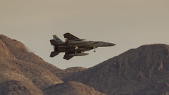 F-15 Recovering At Nellis. (spencer_wilmot) Tags: f15eagle nellis mountains militaryaviation combataircraft aviation aircraft airplane arrival approach plane airbase mcdonnelldouglas eveninglight evening lasvegas jet recovery landing twin twinfin