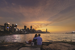 Causeway Bay Typhoon Shelter (mikemikecat) Tags: 銅鑼灣避風塘 causeway bay typhoon shelter couple kissing magic moments hour sky water architecture building exterior sunset built structure two people sitting real men city cloud lifestyles sea togetherness leisure activity women nature relationship cityscape outdoors positive emotion office skyscraper mikemikecat