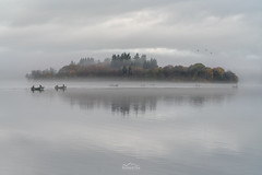 Lateral Line (http://www.richardfoxphotography.com) Tags: lake loch lakeofmenteith fisherman fishing fish mist misty dusk waterfowl reflections scotland scottishhighlands thetrossachs temperatureinversion cloudinversion