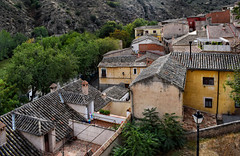 Toledo Rooftops (Jocelyn777) Tags: landscapes views rooftops buildings houses architecture trees foliage mountains toledo castillalamancha spain travel