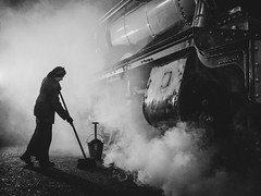 Late night In the steam engine shed. (davepickettphotographer) Tags: httpsdidcotrailwaycentreorguk timeline event events uk oxfordshire england steam engine engines railway shed didcot britain heritage centre vintage reenactment reenactors actors workers working life style winter winters evening railways rail past blackandwhitephotography steamengines didcotrailwaycentre atomosphere greatwesternrailway britishrailways gwr greatwesternsociety dyan supervisor manager foreman oxford wantage