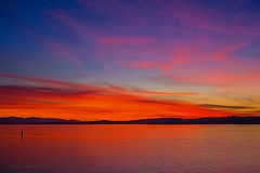 Slice of orange (L@nce (ランス)) Tags: sunset sundown twilight horizon cloud clouds sky redsky canada britishcolumbia victoria jamesbay hollandpoint brotchie ledge lighthouse salishsea nikon juandefuca pacific ocean beautyofwater water reflection