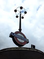 North Pylon (failing_angel) Tags: 180519 london piccadillylinetour londonboroughofenfield charlesholden southgate undergroundstation adamsholdenandpearson londonpassengertransportboard frankpick