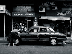 That was the oil pump.... (Aurélien B.) Tags: car blackandwhite street guy man broken buenos aires
