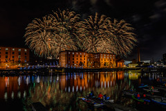 Fireworks over Royal Albert Dock, Liverpool (paullee66416) Tags: bargeboats cloud reflection runbeyond runningman rivermersey pumphouse liverpoolmuseum canoeists canoe dock mersey tree liverpool museum pub tate gallery vivid colours colors