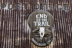 End of the Trail (magnetic_red) Tags: sign rusted rusty rust texture skull cow horns postoffice randsburg california ghosttown