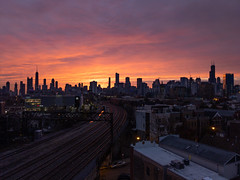 11-3-2019 Sunrise Behind Chicago Skyline - Google Pixel 4 (cshimala) Tags: chicago sunrise skyline chicagoskyline chicagosunrise pixel4 googlepixel4 red orange color colorful traintracks camera phonegoogle pixel architecture sky weather buildings building yellow pink clouds cloudy